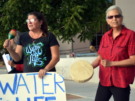Laurie Shade-Neff (left) and Suzen Dopson (right) play and sing Native American songs in support of a rally held in front of the U.S. Federal Buiilding in Las Cruces on Thursday afternoon.  The rally was for stopping the Dakota Access Pipeline from crossing Indian Lands in North and South Dakota.  Photo taken 9/29/16.