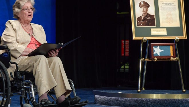 Pauline Lyda Wells Conner, the spouse of U.S. Army 1st Lt. Garlin M. Conner, gives her remarks during a Medal of Honor Induction Ceremony at the Pentagon, in Arlington, Va., June 27, 2018. Conner was posthumously awarded the Medal of Honor June 26, 2018 for actions while serving as an intelligence officer with Headquarters and Headquarters Company, 3rd Battalion, 7th Infantry Regiment, 3rd Infantry Division, during World War II on Jan. 24, 1945.