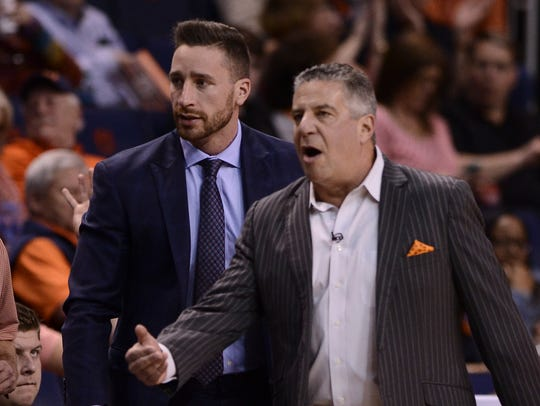 Steven Pearl and Bruce Pearl on the sidelines during