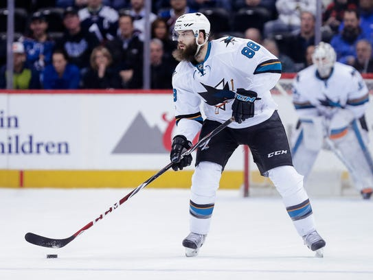 San Jose Sharks defenseman Brent Burns controls the
