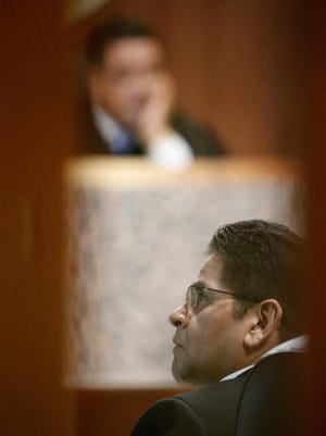 Raymundo Carranza looks at evidence being presented on the screen during the fourth day of his trial in the 409th District Court.