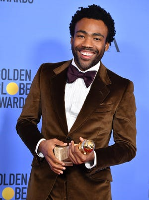 Donald Glover poses in the press room during the 74th Annual Golden Globe Awards.