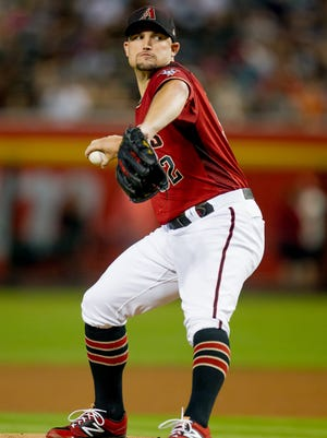 Arizona Diamondbacks starting pitcher Zack Godley throws the ball in the first inning on July 1, 2018, during the Arizona Diamondback's matchup against the San Francisco Giants at Chase Field in Phoenix, Arizona.