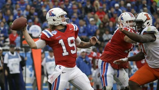 Louisiana Tech quarterback Cody Sokol (19) throws a pass as offensive lineman Mitchell Bell (74) blocks Illinois defensive lineman Jihad Ward (17) during the first half of the Heart of Dallas Bowl NCAA college football game Friday, Dec. 26, 2014, in Dallas. (AP Photo/LM Otero)