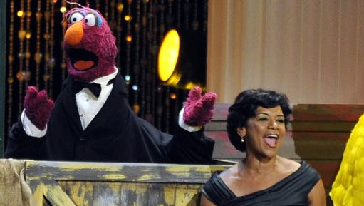 "FILE - In this Aug. 30, 2009 file photo, actress Sonia Manzano, right, performs at the Daytime Emmy Awards in Los Angeles. Manzano, who has played the role of Maria on the groundbreaking kid show ""Sesame Street"" since 1971, is retiring. Manzano broke the news Monday, June 29, 2015 at the American Library Association's annual conference. (AP Photo/Chris Pizzello, File)"