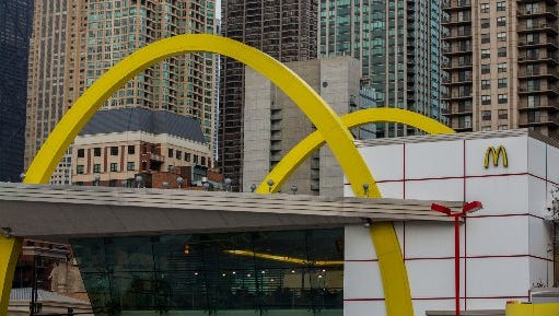 McDonald's says it will switch to cage-free eggs in the U.S. and Canada over the next decade.