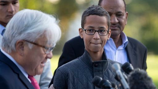 "Ahmed Mohamed, second from right, listens as Rep. Mike Honda, D-Calif., left, speaks during a news conference on Capitol Hill in Washington, Tuesday, Oct. 20, 2015. Mohamed is the 14-year-old ""clock kid"", freshman, who was arrested in Irving, Texas, for bringing an alarm clock science project to his high school teacher. To the far right is Ahmed's uncle Aldean Mohamed. (AP Photo/Carolyn Kaster)"