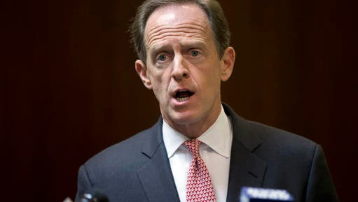 In this May 9, 2016 file photo, Sen. Pat Toomey, R-Pa., speaks during a news conference in Philadelphia. Endangered Toomey is banking on Pennsylvania voters backing him in November even if they oppose fellow Republican Donald Trump, a ticket-splitting strategy that may determine whether the GOP can hang on in key Senate races around the country this election year.