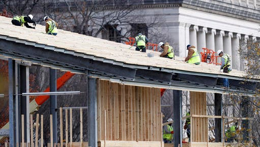 Construction continues on the presidential reviewing stand on Pennsylvania Avenue in front of the White House in Washington, Saturday, Nov. 26, 2016. The reviewing stand is where then President Donald Trump will view the inaugural parade on Jan. 20, 2017.