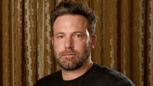 "FILE - In this Sept. 30, 2016 photo, Ben Affleck poses at The Four Seasons Hotel in Los Angeles. Affleck is hoping to flip the script again. In between ""Batman"" movies, he's releasing his directorial follow-up to his Oscar-winning ""Argo"": ""Live By Night,"" adapted from Dennis Lehane's crime novel about a Prohibition era-gangster (Affleck) who decamps from Boston to Ybor City, Florida, to create a rum-running empire."