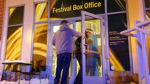 People enter a door leading to the Festival Box Office during the 2017 Sundance Film Festival on Saturday, Jan. 21, 2017, in Park City, Utah. Representatives for the Sundance Film Festival say that their network systems were subject to a cyberattack that caused its box offices to shut down briefly Saturday afternoon.