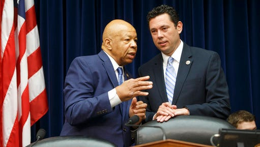 FILE - In this July 7, 2016 file photo, House Oversight and Government Reform Committee Chairman Rep. Jason Chaffetz, R-Utah, right, confers with the committee's ranking member Rep. Elijah Cummings, D-Md. on Capitol Hill in Washington. Congressional investigators are demanding documents and contacting witnesses in a wide-ranging probe of the Defense Department's troubled anti-propaganda efforts against the Islamic State.