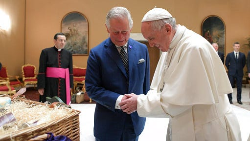 Pope Francis shakes hands with Britain's Prince Charles during a private audience at the Vatican, Tuesday, April 4, 2017. The heir to the British throne is on a three-country trip seen as an effort to reassure European Union nations that Britain remains a close ally despite its impending departure from the bloc.