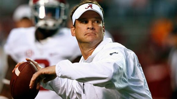 Alabama offensive coordinator Lane Kiffin throws during