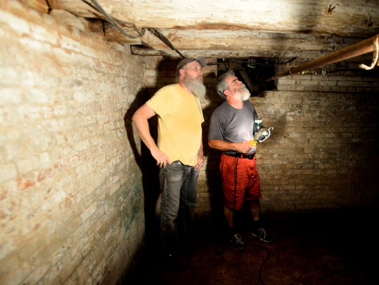 Gary Cathy, left, and Justin Normand stand in their