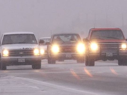 Patchy freezing drizzle and scattered show showers could make driving challenging in the Lansing area on Tuesday and Wednesday.