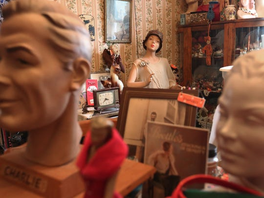 The Steckmessers' living room is full of vintage items that they collect and sell.