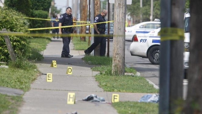 Rochester police investigate a fatal shooting at Bay Road near Sixth Street.