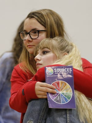 Jennifer King comforts Bryn Yates during a Sources of Strength training session at the Boys and Girls Club of the Fox Valley. The program encourages students to dream up and implement their own ideas for preventing suicide in their schools.