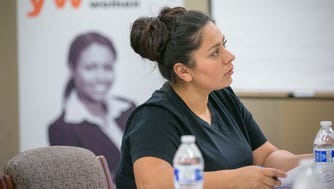 Monica Cook attends a financial seminar at Fresh Start Women's Foundation in Phoenix on April 2. Although some workers are turning to temporary-employment agencies after having difficulty finding permanent jobs, others prefer the flexibility of temporary work.