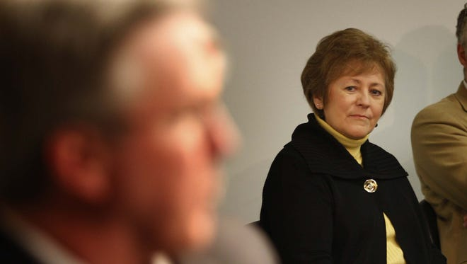 University president Sally Mason looks on as Fran McCaffery is introduced as Iowa men's basketball coach in March 2010.
