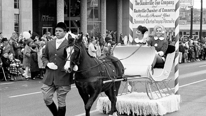 The Nashville Gas Company and Nashville Chamber of Commerce are presenting the annual Christmas parade to a crowd of 75,000 along the route from 23rd and West End to Second and Broadway Dec. 4, 1966.