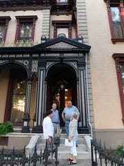 Participants leave the historic Reitz Home following a rehearsal  for the 25th annual Reitz Home Mystery: Murder on Main Street Thursday, August 10, 2017.