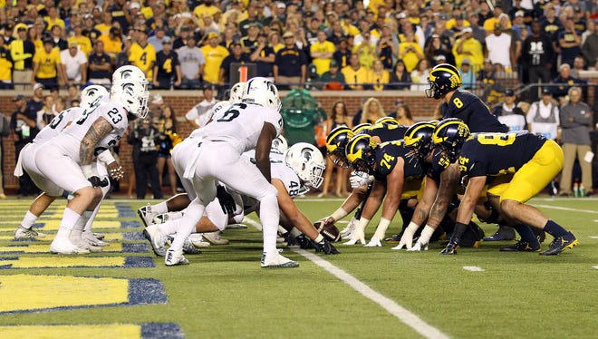 Michigan prepares to snap the ball against the Michigan State defense in the second half of their game at Michigan Stadium on Oct. 7, 2017. MSU won, 14-10.