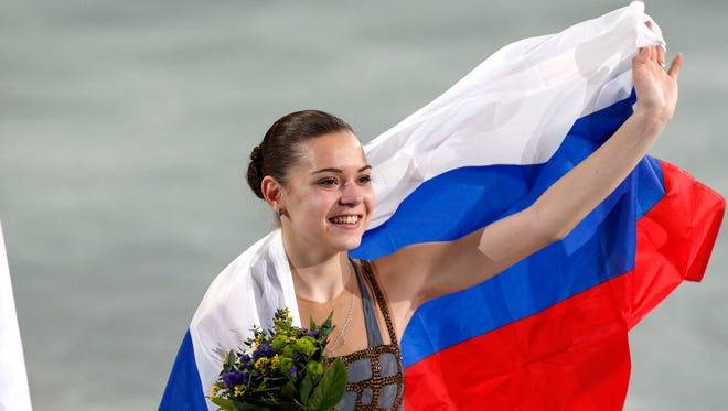 Adelina Sotnikova of Russia reacts after placing first in the ladies free skate program during the Sochi 2014 Olympic Winter Games at Iceberg Skating Palace.