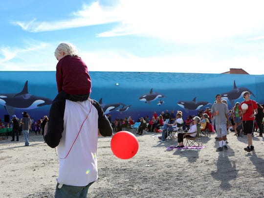 People attend the orca wall dedication and neighborhood block party in Desert Hot Springs on Sunday.