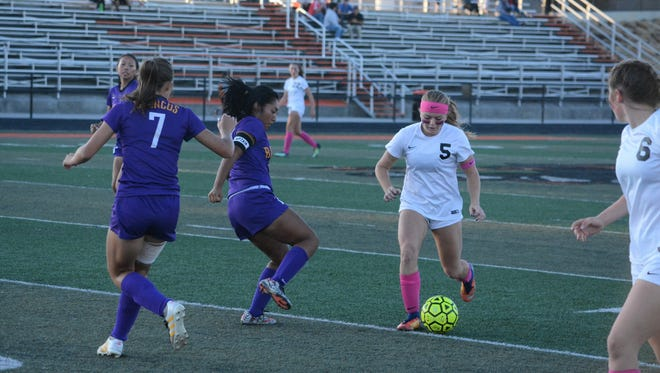 Aztec's Autumn Peterson moves the ball going into attack formation down the field during the first half of the Tigers' District 1-5A match against Kirtland Central last Thursday at Fred Cook Stadium. Aztec clinches district with a win Thursday at Farmington.