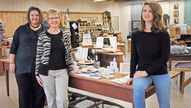 From left, Stephanie Van't Sant, Amana Woolen Mill manager; Cindy Bowen, creative designer, and Ali Cooper, weaver-designer, are part of the creative force behind a new line of products available at the Woolen Mill.
