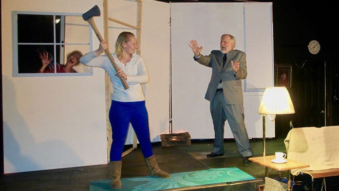 From left, Mrs. Thompson (Martha Winters) screams as Emily (Lauren Shelton) raises an ax at her husband (Duncan Hoehn)  while the Narrator (Kinisha Mims) laughs.