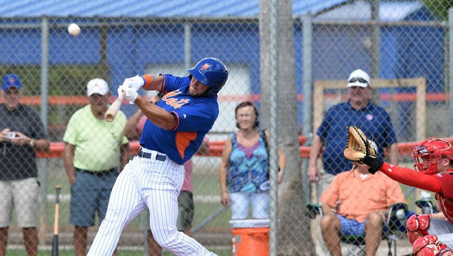Tim Tebow hits a solo home run in his first at bat during the first inning of  his first instructional league baseball game for the New York Mets against the St. Louis Cardinals instructional club Wednesday, Sept. 28, 2016, in Port St. Lucie, Fla.