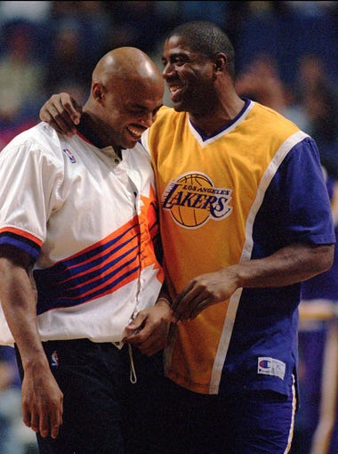 "Phoenix Suns' Charles Barkley, left, and Los Angeles Lakers' Earvin ""Magic"" Johnson share a light moment prior to their NBA game in Phoenix, Friday, March 8, 1996. (AP Photo/Scott Troyanos)"