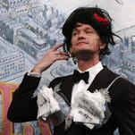 Neil Patrick Harris added a few extra touches to his tux before accepting Harvard's Hasty Pudding Pot.