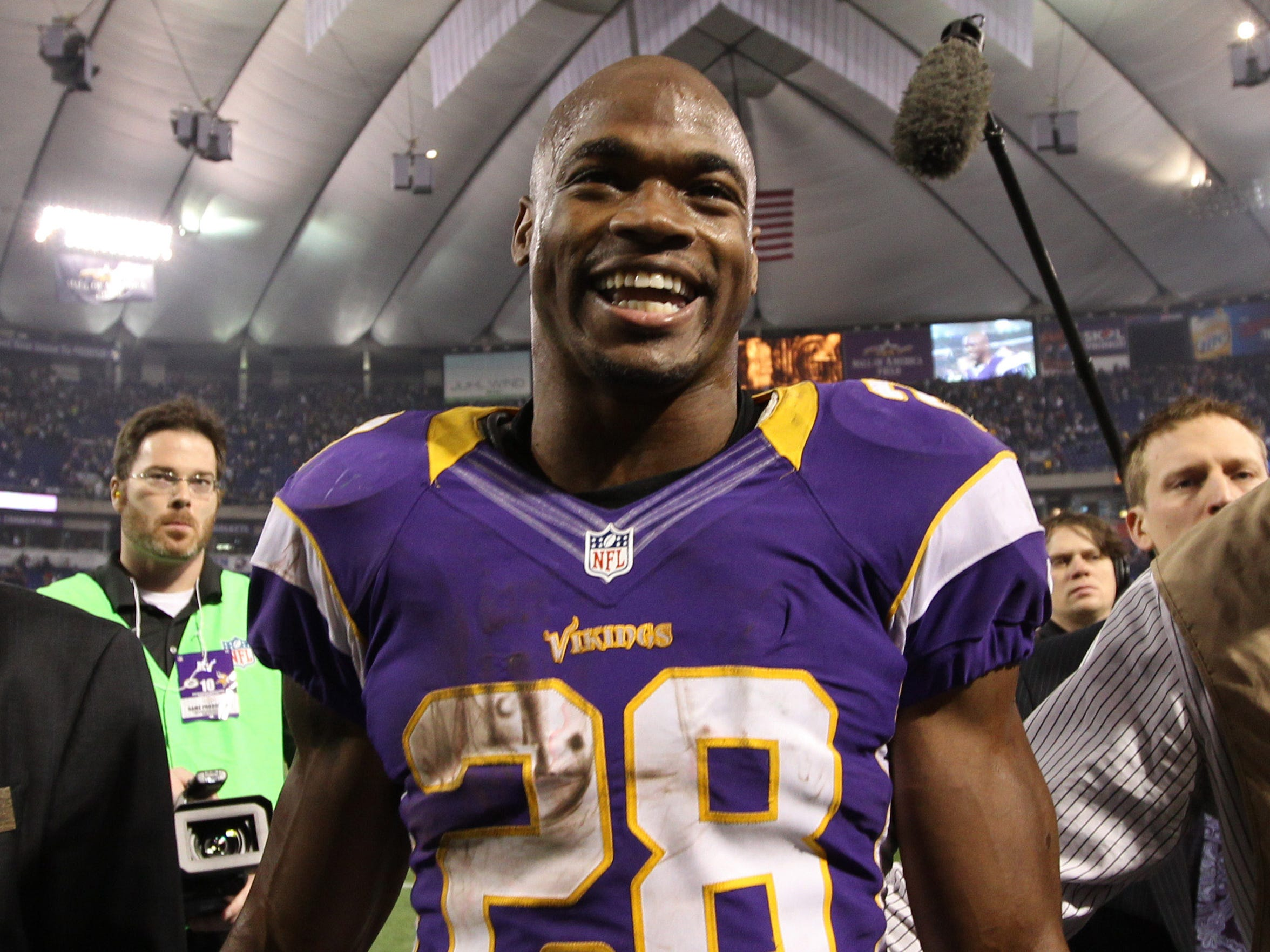 Adrian Peterson walks off the Metrodome field after