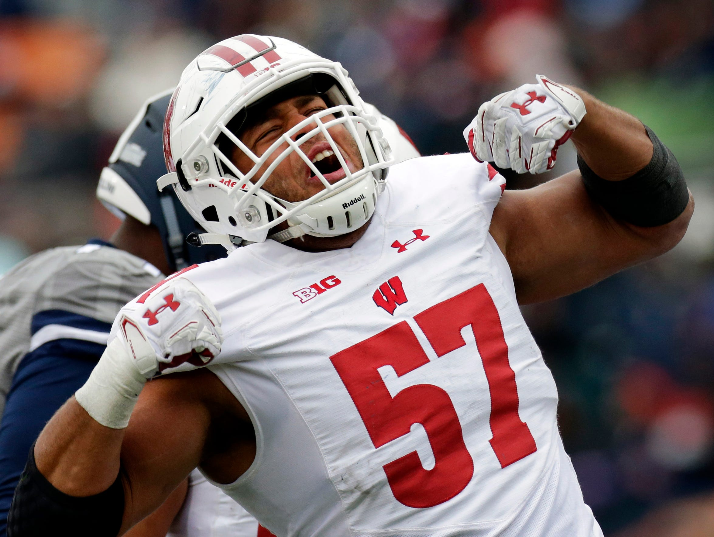 Wisconsin defensive lineman Alec James is jacked up after his sack of Illinois quarterback Cam Thomas for a 10-yard loss during the third quarter during a game earlier this season. James, a Brookfield East graduate, has started all 12 games on the defensive line.