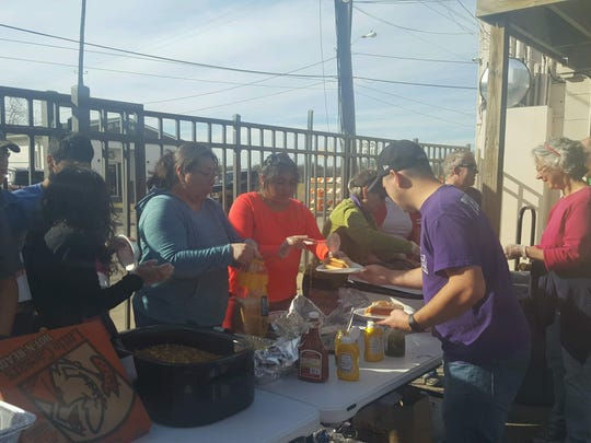 Volunteers hand out meals to the homeless at the Good Samaritan Rescue Mission.