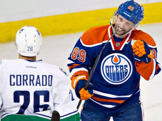 This Sept. 21, 2013 photo shows Edmonton Oilers Sam Gagner, right, in Edmonton. Gagner was traded twice within 90 minutes Sunday night, first from the Edmonton Oilers to Tampa Bay and then from the Lightning to the Arizona Coyotes. (AP Photo/The Canadian Press, Jason Franson)