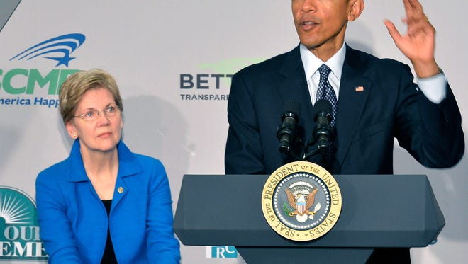 President Obama and Sen. Elizabeth Warren, D-Mass.
