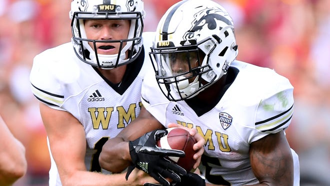Western Michigan quarterback Jon Wassink, right, made his first career start against USC. LeVante Bellamy and the Broncos' running game helped him out, rushing for 263 yards against the fourth-ranked Trojans.