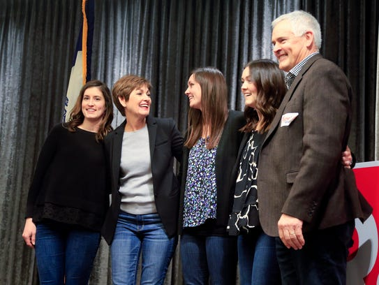 Gov. Kim Reynolds brings her family on stage during