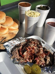 Rollin' Smoke BBQ offers an affordable lunch menu and this, The Dinner Bell party pack, which feeds five for $28.99 and includes one and a half pounds of pulled pork, six buns, three pints of sides and sauce.