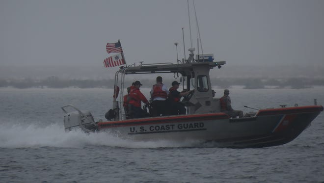 Search boats in heavy fog about a mile east of Navarre Beach Bridge.