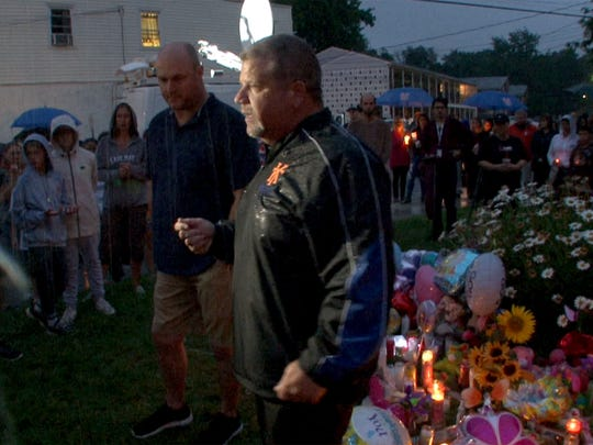 """In a driving rain, Keansburg Mayor George Hoff speaks to people gathered for a vigil in memory of AbbieGail """"Abbie"""" Smith, 11, Friday night,  July 14, 2017.  Smith was killed by a neighbor in her Keansburg apartment complex."""
