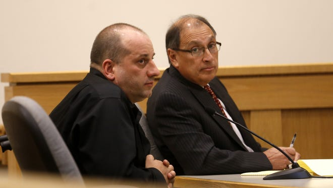 Bobby Willis, left, sits with his attorney, Bob Cooper, on March 25, 2016, during a hearing in Farmington District Court.