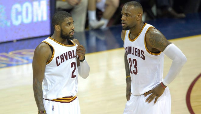 Cleveland Cavaliers guard Kyrie Irving (2) and  forward LeBron James (23) need to come back from a 2-1 deficit.