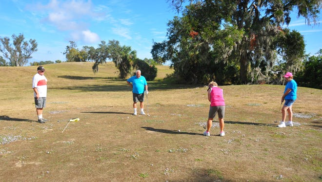 Bob and Donna Langdeau  of Vermont play 18 holes with Doug and Jackie Grieve of Canada. Sam's Golf, a 5- acre 18-hole golf Course in Sharpes off of U.S. 1 is expected to closing soon. The property is planned to be a housing development by D.R. Horton called Panther Ridge.