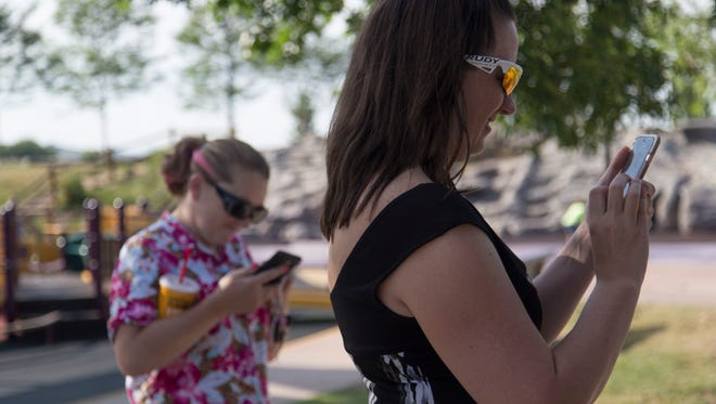 Aimee Oke plays Pokemon Go during the Coloradoan Pokemon Go meet up in Spring Canyon Park Thursday, July 14, 2016.